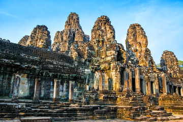 Beautiful Bayon temple in Angkor Thom on the sunset. Ancient Khmer architecture. Location: Siem reap, Cambodia.er architecture.
