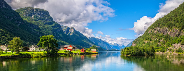 Foto op Plexiglas Scandinavië Amazing nature view with fjord and mountains. Beautiful reflection. Location: Scandinavian Mountains, Norway. Artistic picture. Beauty world. The feeling of complete freedom
