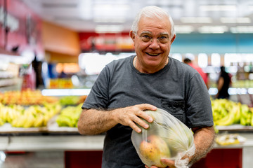 Portrait of a senior man at the supermarket