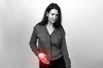 Woman with pain in the abdomen ,appendix pain, an inflammation of the appendix. Black and white with a red accent