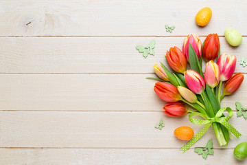 Spring easter tulips in bucket on white vintage background.