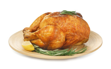 Plate with delicious whole roasted chicken on white background