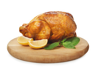 Wooden board with delicious whole roasted chicken on white background