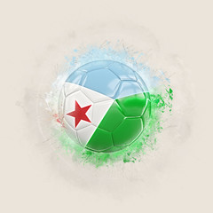 Grunge football with flag of djibouti