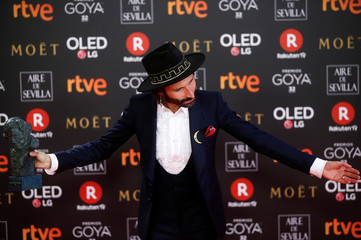 Singer Leiva, who won the Best Original Song award, reacts with his trophy during the Spanish Film Academy's Goya Awards ceremony in Madrid