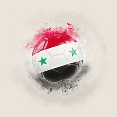 Grunge football with flag of syria