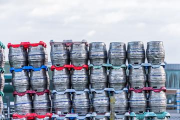 Shiny metal beer kegs barrels of beer stacked for dispatch
