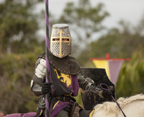 unknown knight looking at you waiting to battle