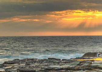 Sunrise Seascape and Rock Shelf