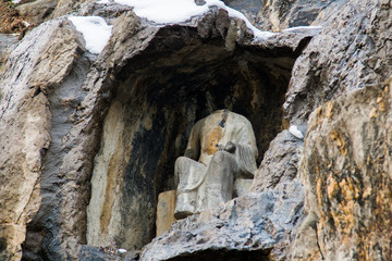 Close-up Stone Buddha Statue Carved from the mountains in winter