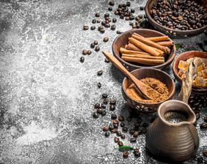 Fresh coffee in a clay turkey with crystals of sugar and cinnamon.