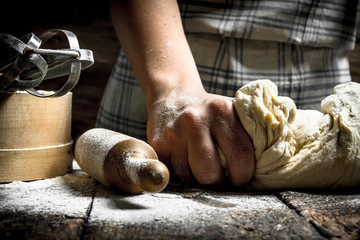 Dough background. Preparation of dough with tools.