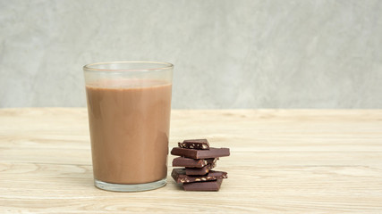 Chocolate milk on a wooden table.