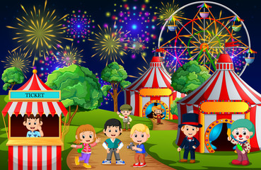 Many Children and people worker having fun in amusement park at night