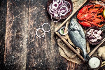 Fototapete - Seafood in an old tray.