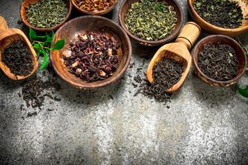 Printed kitchen splashbacks Spices Different kinds of fragrant tea in bowls.