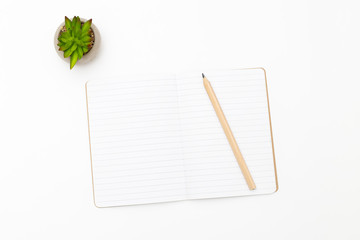 Notebook and pencil on white background. Minimalist mock up