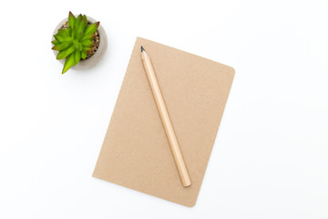 Pencil and notebook of kraft paper on a white background.  Scandinavian style.
