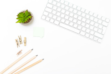 Keyboard and office supplies on a white background. Scandinavian style