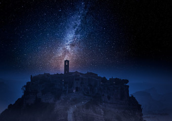 Milky way and old town of Bagnoregio at night, Italy