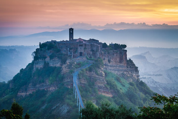 Old town of Bagnoregio on hill at dusk, Italy