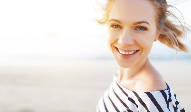 happy woman enjoying freedom and laughs on sea