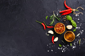 Fresh herbs and spices on black stone table
