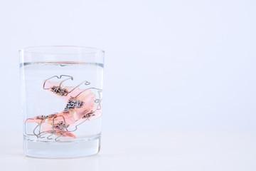 braces in water glass