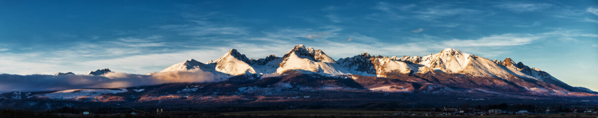 Panoramic shot of winter mountain landscape during sunset. High Tatras, Slovakia, from Poprad