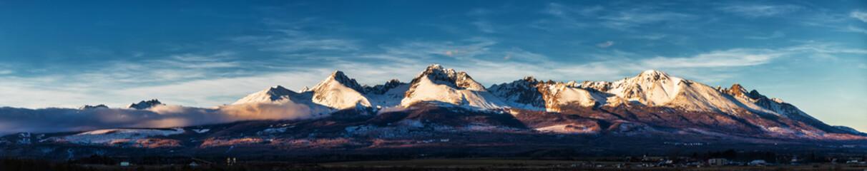Fototapeta Panoramic shot of winter mountain landscape during sunset. High Tatras, Slovakia, from Poprad obraz