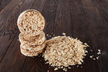 Healthy eating concept. Dry rolled oatmeal on wooden table
