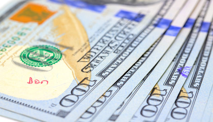 United States dollar banknotes. Cash money closeup photo. Currency background.