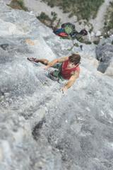 Mature male climber climbing on a tufa limestone wall