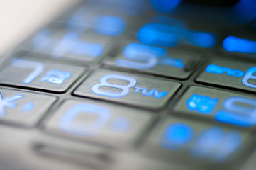 Mobile phone blue numbers close up macro shot for backgroun