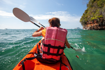 Women are kayaking in the open sea at the Krabi shore, Thailand