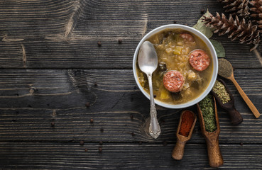 Slovak christmas cabbage soup with mushrooms on natural background.