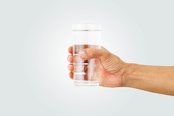 Man hand holding glass of drinking water isolated on white background