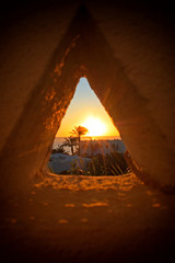 Foto auf Acrylglas Mittlerer Osten View of the sunset through a triangular hole in Sharm-el-Sheikh, Egypt