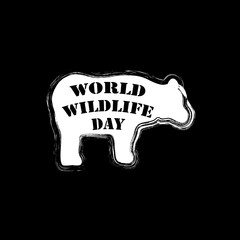 World wildlife day lettering with silhouette of bear.