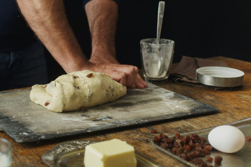Wall Mural - Male hands knead dough for cooking cross buns