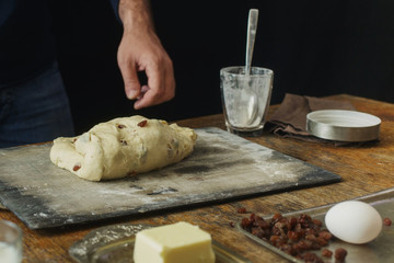 Wall Mural - Male hands knead dough for cooking homemade cross buns