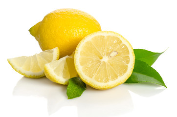 Lemon and half with leaves  isolated on white background