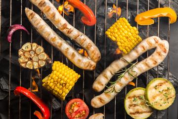 Preparing grilled sausage and vegetables