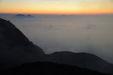 Spectacular sunset over the Aeolian Islands seen from the summit of Volcano Stromboli, Sicily, Italy