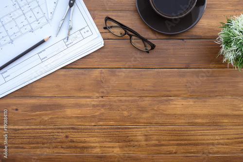 Flat lay of top view desk work table architect with drawing