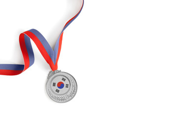 Silver medal on white background as a symbol of victory in sports competition in South Korea