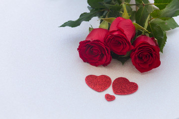 occasional beautiful red roses with decorative hearts and a place for dedications or wishes