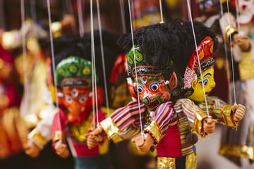 Masks, dolls and souvenirs in street shop in Kathmandu, Nepal.