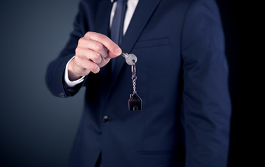 Young man hand over keys