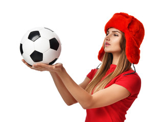 Fan sport woman player in red uniform and russian winter hat hold soccer ball celebrating